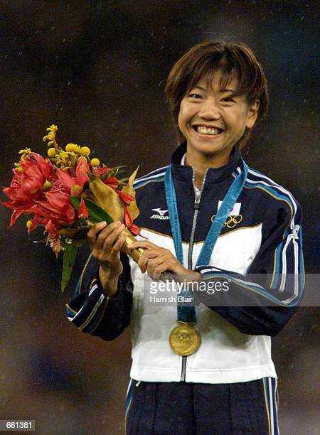 Women's marathon gold medalist Naoko Takahashi of Japan smiles after receing her medal September 24 2000 at the Sydney 2000 Olympic Games in Sydney...