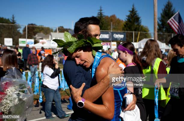 Women's marathon winner Tracy Guerrette of Saint Agatha hugs her coach Rob Gomez of Windham after the Maine Marathon in Portland on Sunday October 1...
