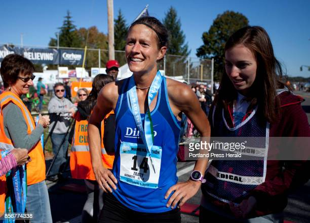 Women's marathon winner Tracy Guerrette of Saint Agatha rests after crossing the finish line during the Maine Marathon in Portland on Sunday October...