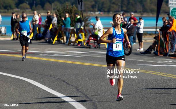 Women's marathon winner Tracy Guerrette of Saint Agatha runs to the finish line during the Maine Marathon in Portland on Sunday October 1 2017