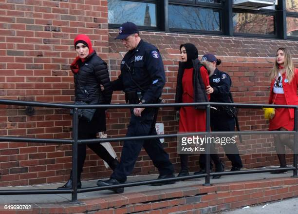 Women's March coorganizer Linda Sarsour and other organizers of the Day Without a Woman rally are escorted into the 7th precinct after being arrested...