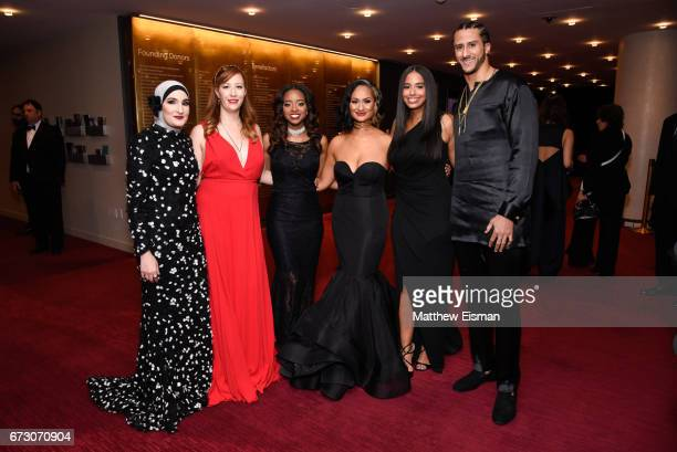 Women's March National CoChairs Linda Sarsour Bob Bland Tamika D Mallory and Carmen Perez pose for a photo together with Nessa and NFL quarterback...