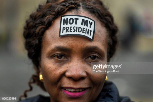 Women's March participant Suzanne Damas of Brooklyn New York wears a simple sticker on her forehead to let people know what she thinks of Donald...