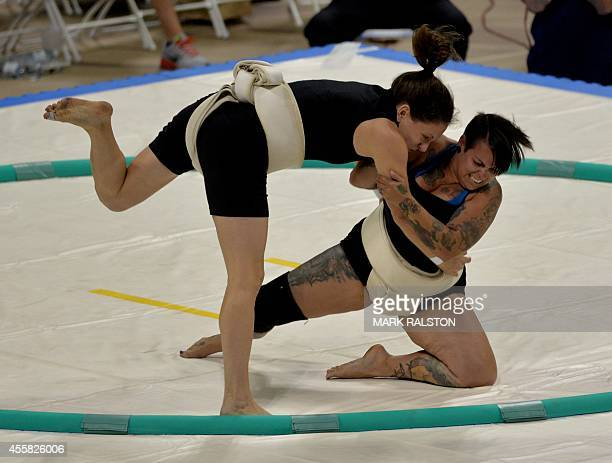 Women's middleweight Sumo wrestlers fight during their bout at the US Sumo Open in Long Beach on September 20 2014 AFP PHOTO/Mark RALSTON
