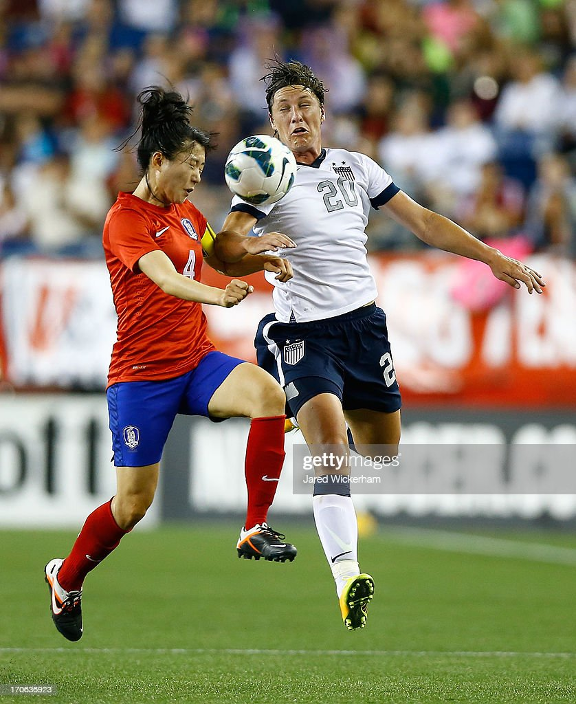 US Womens National forward <a gi-track='captionPersonalityLinkClicked' href=/galleries/search?phrase=Abby+Wambach&family=editorial&specificpeople=162757 ng-click='$event.stopPropagation()'>Abby Wambach</a> #20 and Korea Republic defender Shim Seoyeon #4 fight for the ball in the second half during the game at Gillette Stadium on June 15, 2013 in Foxboro, Massachusetts.