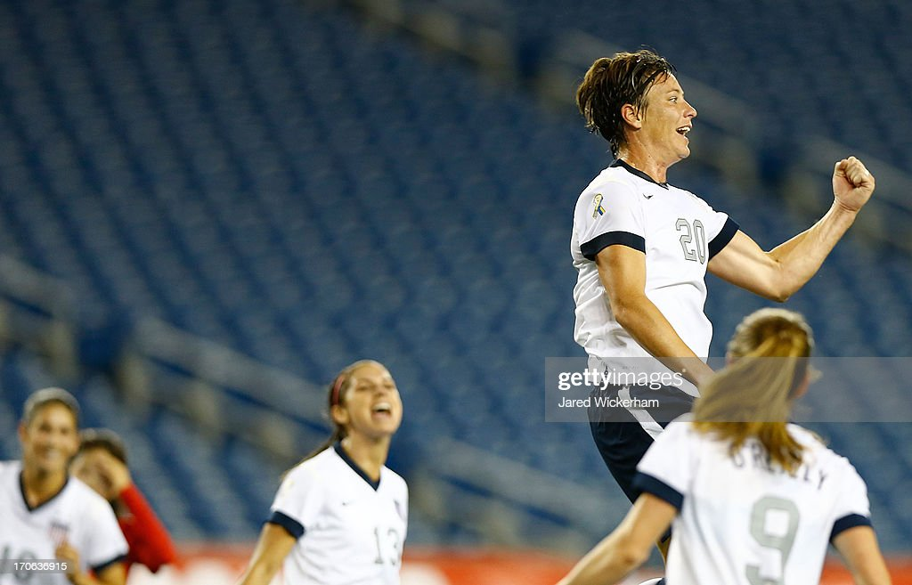 US Womens National forward <a gi-track='captionPersonalityLinkClicked' href=/galleries/search?phrase=Abby+Wambach&family=editorial&specificpeople=162757 ng-click='$event.stopPropagation()'>Abby Wambach</a> #20 celebrates after scoring a goal on a penalty kick late in the second half against Korea Republic during the game at Gillette Stadium on June 15, 2013 in Foxboro, Massachusetts.