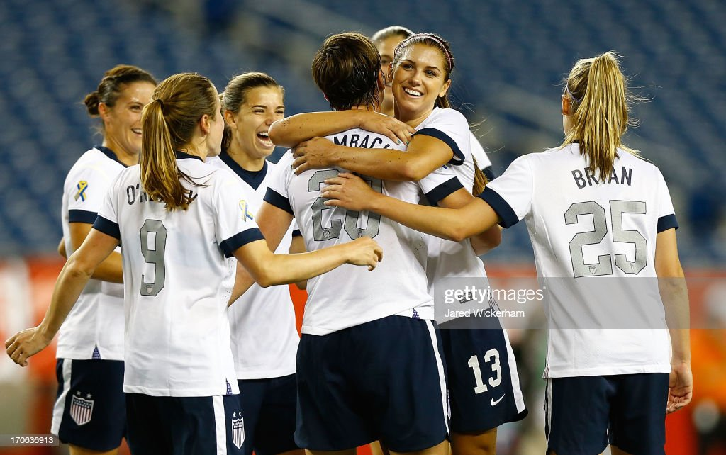 US Womens National forward <a gi-track='captionPersonalityLinkClicked' href=/galleries/search?phrase=Abby+Wambach&family=editorial&specificpeople=162757 ng-click='$event.stopPropagation()'>Abby Wambach</a> #20 is congratulated by teammate US Womens National forward <a gi-track='captionPersonalityLinkClicked' href=/galleries/search?phrase=Alex+Morgan+-+Soccer+Player&family=editorial&specificpeople=1057310 ng-click='$event.stopPropagation()'>Alex Morgan</a> #13 after scoring a goal on a penalty kick late in the second half against Korea Republic during the game at Gillette Stadium on June 15, 2013 in Foxboro, Massachusetts.