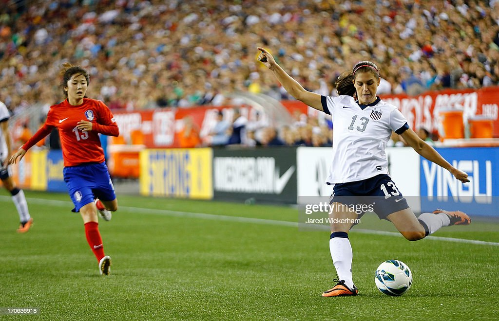 US Womens National forward <a gi-track='captionPersonalityLinkClicked' href=/galleries/search?phrase=Alex+Morgan+-+Soccer+Player&family=editorial&specificpeople=1057310 ng-click='$event.stopPropagation()'>Alex Morgan</a> #13 crosses a ball against Korea Republic during the game at Gillette Stadium on June 15, 2013 in Foxboro, Massachusetts.