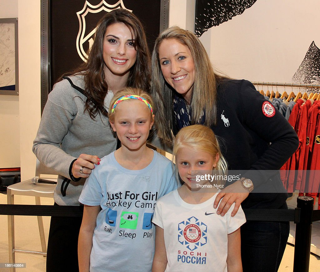 U.S. Women's National Hockey Team forwards <a gi-track='captionPersonalityLinkClicked' href=/galleries/search?phrase=Hilary+Knight+-+Hockey+Player&family=editorial&specificpeople=6718401 ng-click='$event.stopPropagation()'>Hilary Knight</a> (L) and <a gi-track='captionPersonalityLinkClicked' href=/galleries/search?phrase=Meghan+Duggan&family=editorial&specificpeople=4234644 ng-click='$event.stopPropagation()'>Meghan Duggan</a> pose for photos with fans during an appearance at the NHL Powered by Reebok Store on October 28, 2013 in New York City. The U.S. Women's team is in New York City as part of the U.S. Olympic Committee's '100 Days Out' celebration for the 2014 Olympic Winter Games.