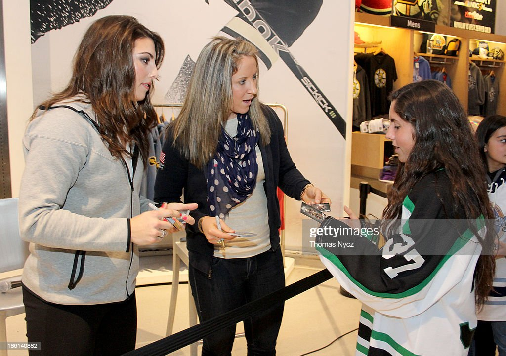 U.S. Women's National Hockey Team forwards <a gi-track='captionPersonalityLinkClicked' href=/galleries/search?phrase=Hilary+Knight+-+Hockey+Player&family=editorial&specificpeople=6718401 ng-click='$event.stopPropagation()'>Hilary Knight</a> (L) and <a gi-track='captionPersonalityLinkClicked' href=/galleries/search?phrase=Meghan+Duggan&family=editorial&specificpeople=4234644 ng-click='$event.stopPropagation()'>Meghan Duggan</a> sign autographs for fans during an appearance at the NHL Powered by Reebok Store on October 28, 2013 in New York City. The U.S. Women's team is in New York City as part of the U.S. Olympic Committee's '100 Days Out' celebration for the 2014 Olympic Winter Games.