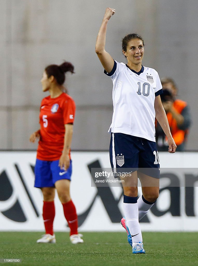 US Womens National midfielder <a gi-track='captionPersonalityLinkClicked' href=/galleries/search?phrase=Carli+Lloyd&family=editorial&specificpeople=736799 ng-click='$event.stopPropagation()'>Carli Lloyd</a> #10 celebrates after scoring a goal in the second half against Korea Republic during the game at Gillette Stadium on June 15, 2013 in Foxboro, Massachusetts.