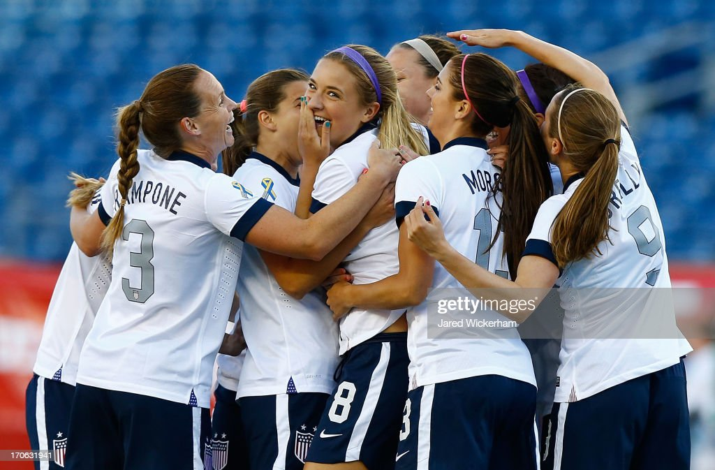 US Womens National midfielder Kristie Mewis #8 celebrates with teammates following her goal in the first half against Korea Republic during the game at Gillette Stadium on June 15, 2013 in Foxboro, Massachusetts.