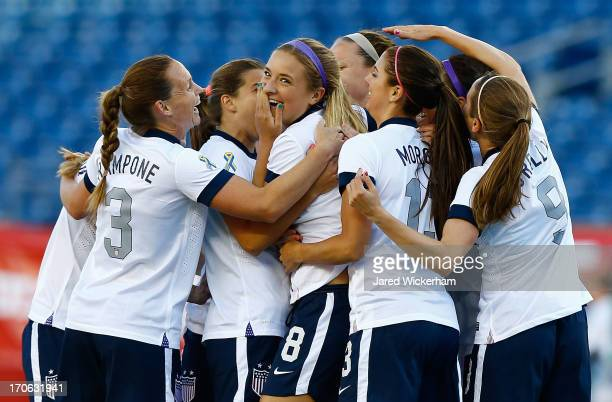 Womens National midfielder Kristie Mewis celebrates with teammates following her goal in the first half against Korea Republic during the game at...