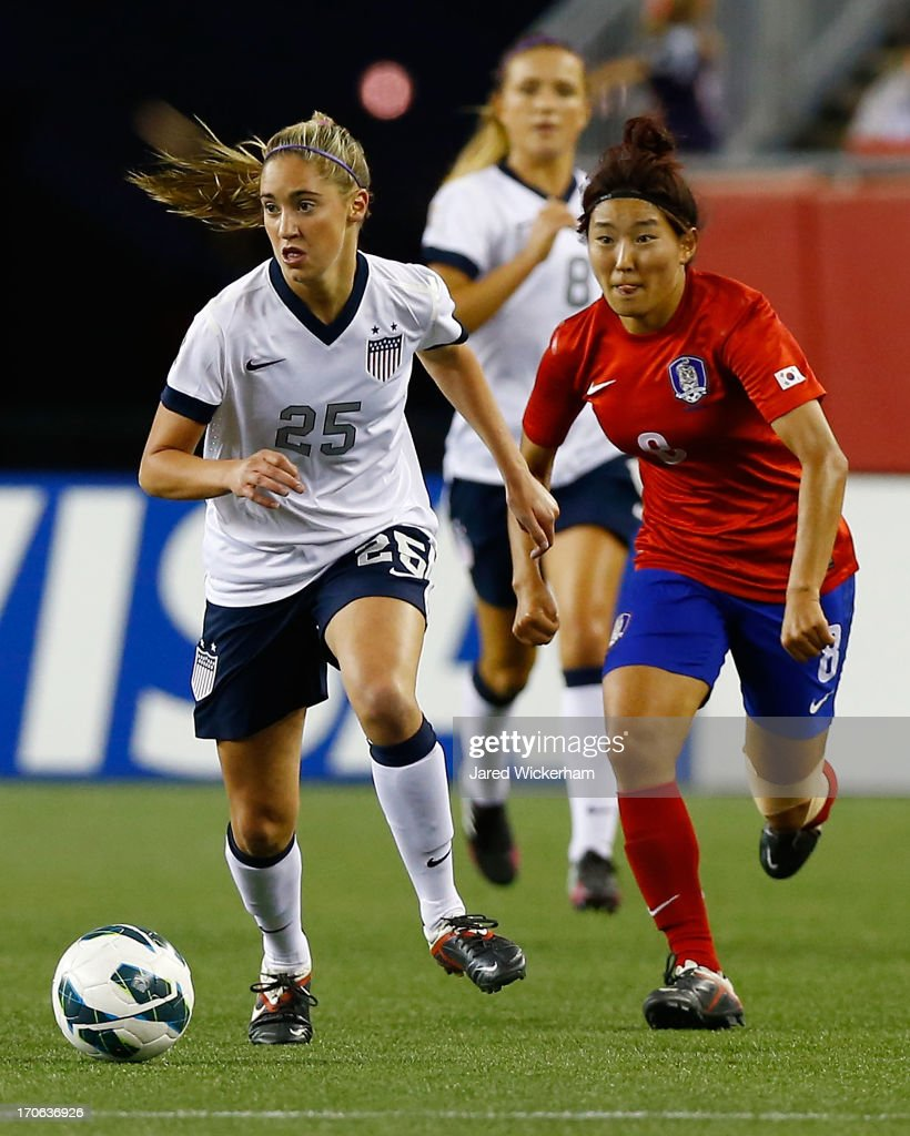 US Womens National midfielder Morgan Brian #25 carries the ball in front of Korea Republic midfielder Cho Sohyun #8 during the game at Gillette Stadium on June 15, 2013 in Foxboro, Massachusetts.