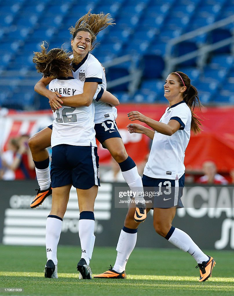 US Womens National midfielder <a gi-track='captionPersonalityLinkClicked' href=/galleries/search?phrase=Tobin+Heath&family=editorial&specificpeople=861695 ng-click='$event.stopPropagation()'>Tobin Heath</a> #17 jumps into the arms of teammate US Womens National midfielder Lauren Cheney #12 following Cheny's goal in the first half against Korea Republic during the game at Gillette Stadium on June 15, 2013 in Foxboro, Massachusetts.
