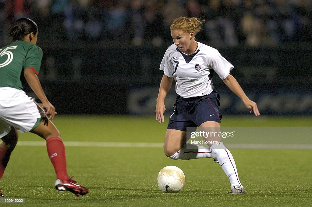 US Women's National Soccer Team defender Lori Chalupny dribbles the ball during an exhibition match against Mexico at PAETEC Park in Rochester New...