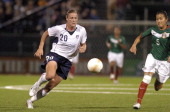 US Women's National Soccer Team forward Abby Wambach controls the ball with Mexico defender Maria Castillo in pursuit during an exhibition match...