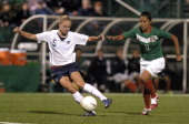 US Women's National Soccer Team forward Lindsay Tarpley controls the ball past Mexico defender Paty Perez during an exhibition match at PAETEC Park...