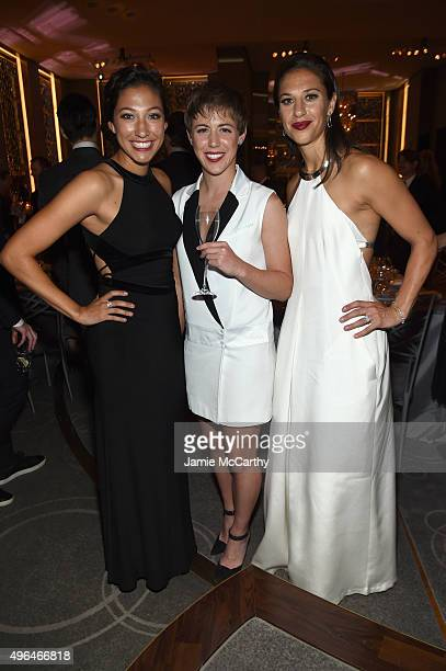 US Women's National Soccer team players Christen Press Meghan Klingenberg and Carli Lloyd attend the 2015 Glamour Women of The Year Awards dinner...