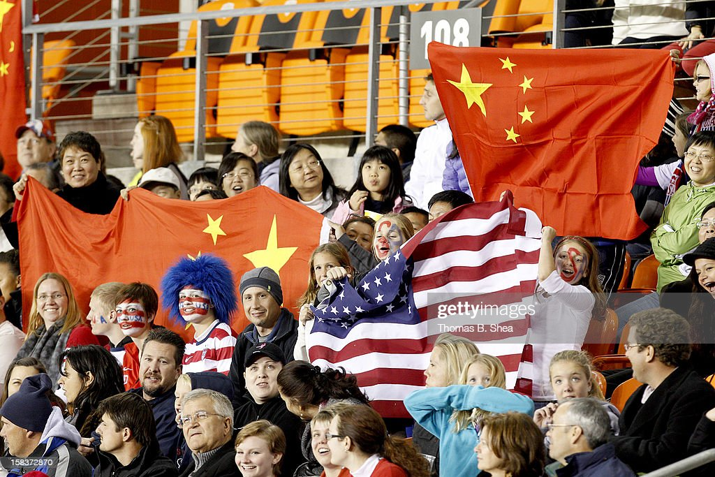 U.S. Women's National Team fans and China Women's National Team fan watch China Women's National Team play against the China Women's National Team in an international friendly game at BBVA Compass Stadium on December 12, 2012 in Houston, Texas. USA won 4 to 0.