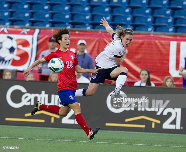 US Women's National Team player Heather O'Reilly drives for the goal against Korea Republic's player Kim Hyeri during the friendly match between the...