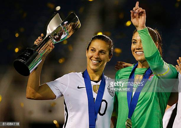USA women's national team soccer players Carli Lloyd and Hope Solo celebrates their win of the SheBelieves Cup soccer tournament March 9 2016 in Boca...