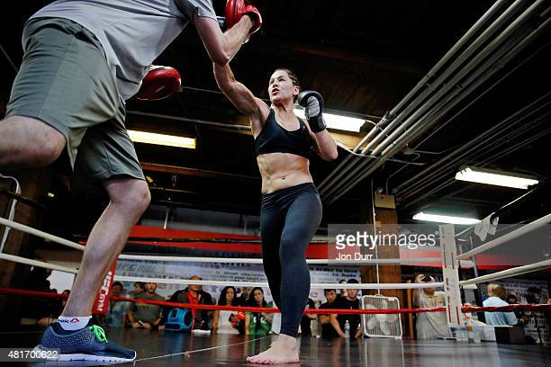 UFC women's No 5 bantamweight contender Jessica Eye with boxing coach Alex Cooper during UFC Fight Night Open Workouts at UFC Gym River North on July...