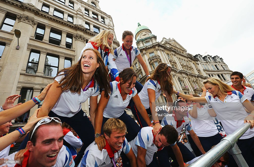 Women's Pair Rowing gold medallist Helen Glover (centre L) and members of the Great Britain rowing team build a human pyramid as they take part in the London 2012 Victory Parade for Team GB and Paralympics GB athletes through central London on September 10, 2012 in London, England.