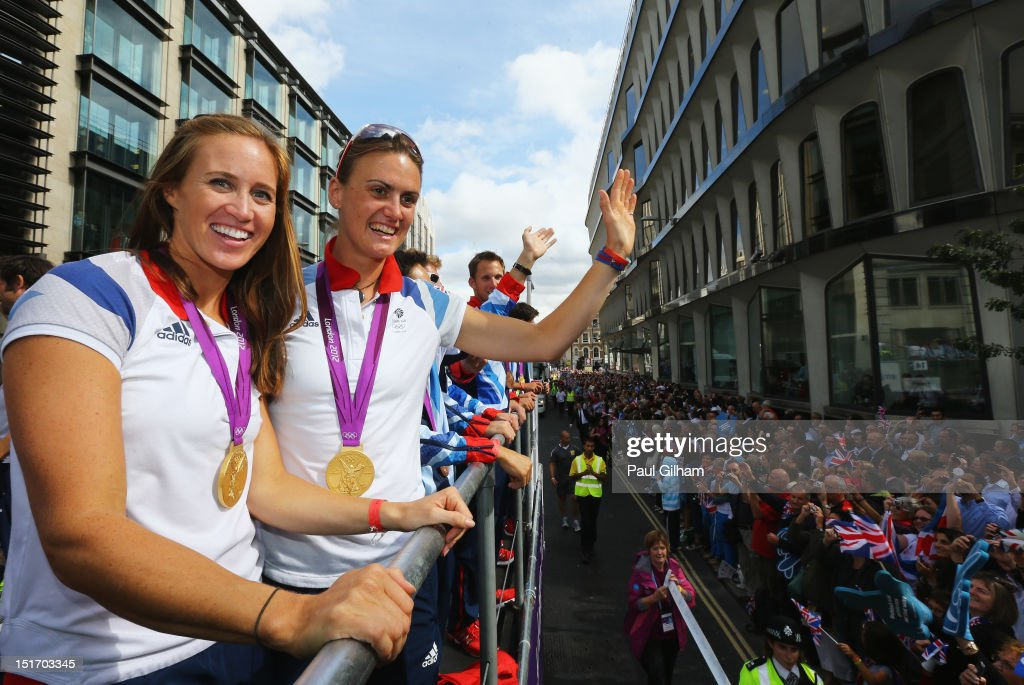 Women's Pair Rowing gold medallists Helen Glover (L) and Heather Stanning take part in the London 2012 Victory Parade for Team GB and Paralympics GB athletes through central London on September 10, 2012 in London, England.