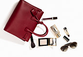 Women's personal accessories(handbag, sunglasses, lipstick, perfume) isolated on silver background ( with clipping path)