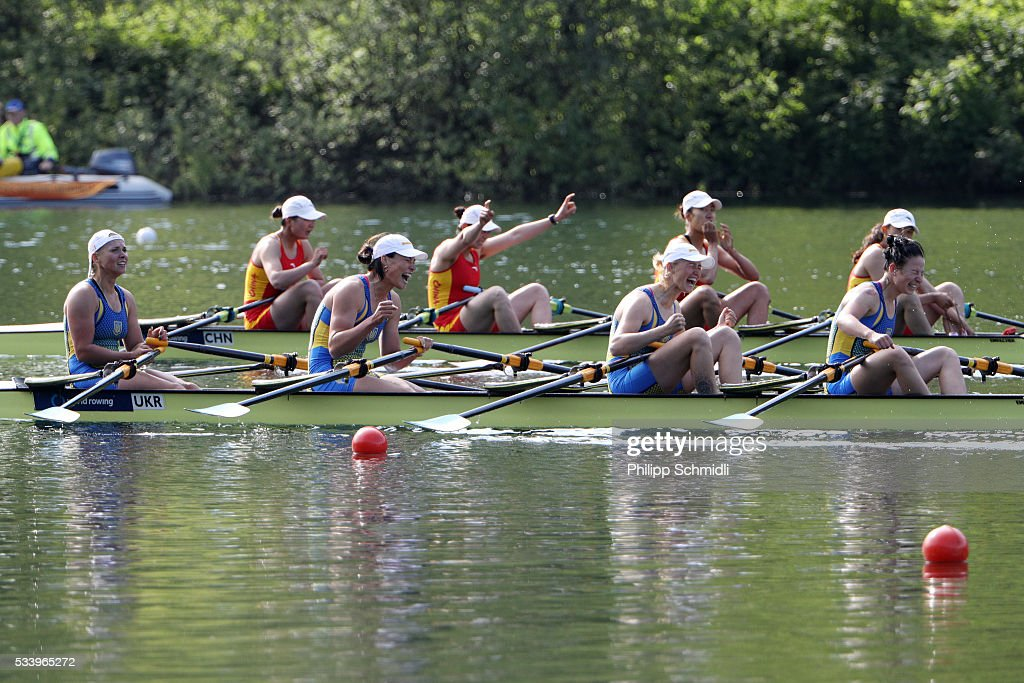 Women's Quadruple Sculls teams of Ukraine (bottom) and China celebrate after qualifying for the 2016 Summer Olympic Games in Rio during Day 3 of the 2016 FISA European And Final Olympic Qualification Regatta at Rotsee on May 24, 2016 in Lucerne, Switzerland.