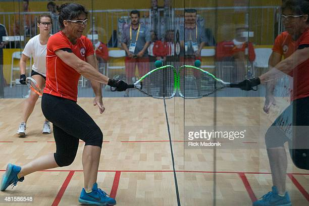 TORONTO JULY 22 2015 Women's Racquetball Doubles Round 16 at Exhibition Hall Canadians Chris Richardson watches as opponent Angela Grisar hits...