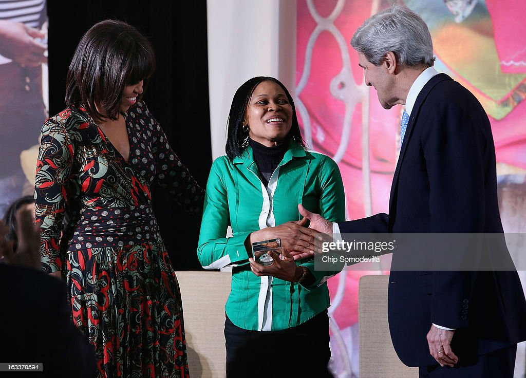 Women's rights advocate Dr. Josephine Obiajulu Odumakin (C) of Nigeria is congratulated by U.S. Secretary of State <a gi-track='captionPersonalityLinkClicked' href=/galleries/search?phrase=John+Kerry&family=editorial&specificpeople=154885 ng-click='$event.stopPropagation()'>John Kerry</a> (R) and U.S. first lady <a gi-track='captionPersonalityLinkClicked' href=/galleries/search?phrase=Michelle+Obama&family=editorial&specificpeople=2528864 ng-click='$event.stopPropagation()'>Michelle Obama</a> after Odumakin received the International Women of Courage award at the State Department March 8, 2013 in Washington, DC. In celebration of the 102nd International Women's Day, the State Department honored nine women from around the world with the International Women of Courage Award, including the 23-year-old Indian woman known only as 'Nirbhaya,' who died from injuries she received after being gang raped by six men last December in Delhi.