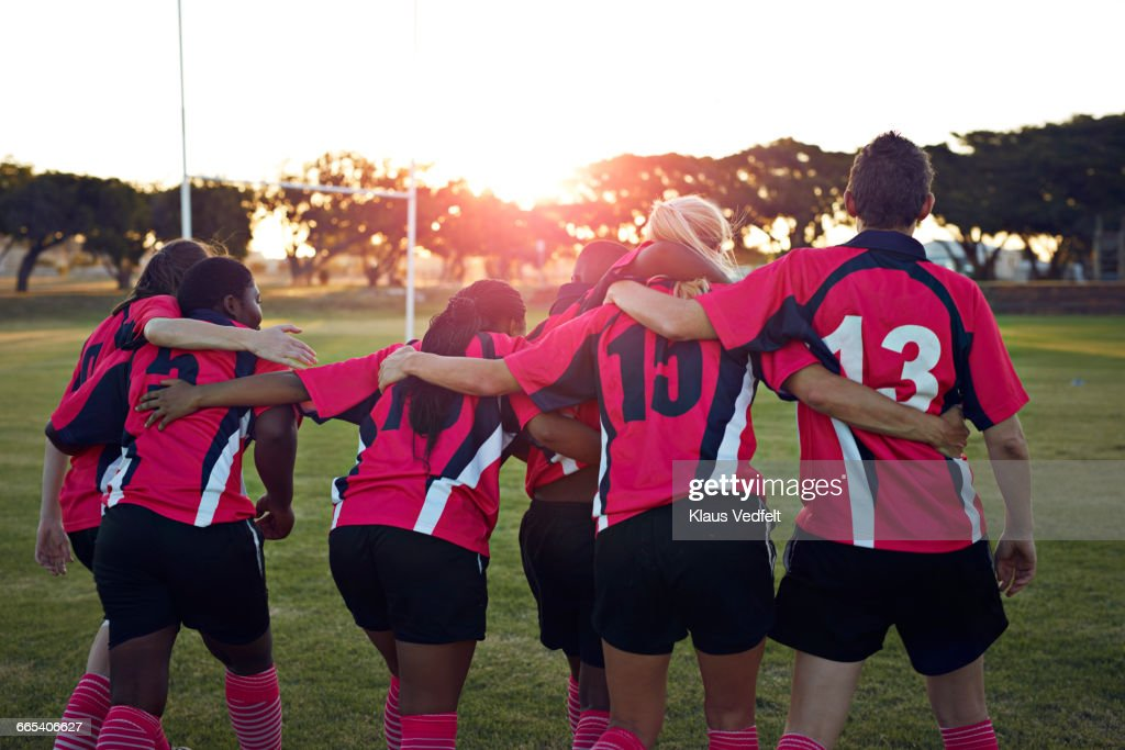 Womens rugby team walking together towards sunset : Stock Photo