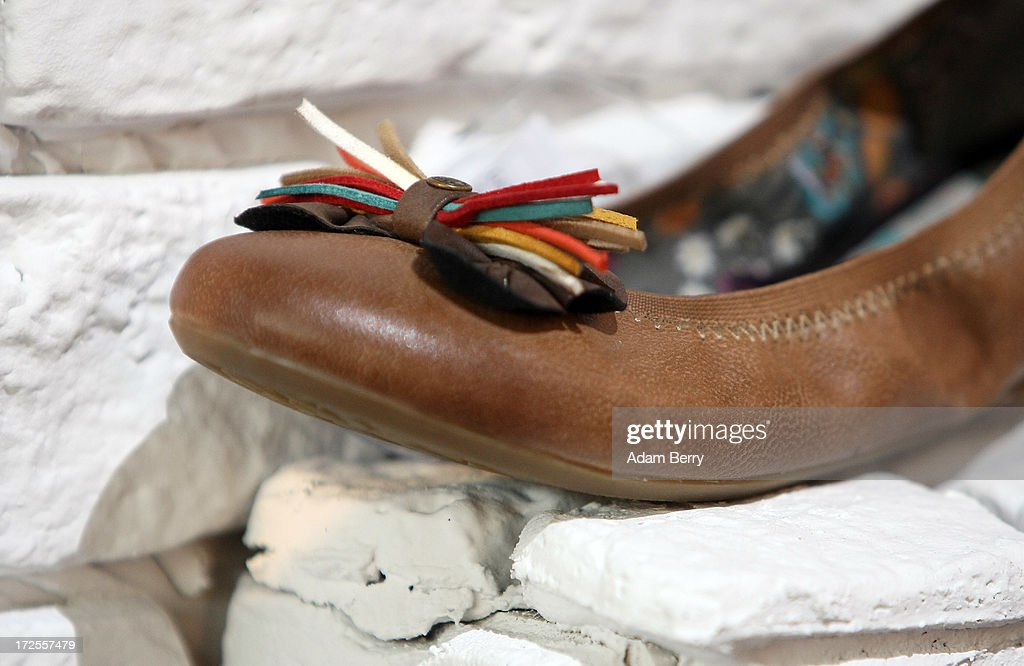 A women's shoe sits on display at the Mustang brand stand at the Bread and Butter trade show at the former Tempelhof airport during Mercedes-Benz Fashion Week in Berlin on July 3, 2013 in Berlin, Germany.