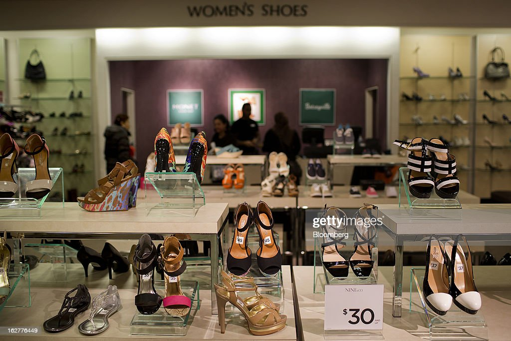 Women's shoes are displayed for sale at a J.C. Penney Co. store in the Queens borough of New York, U.S., on Tuesday, Feb. 26, 2013. Confidence among U.S. consumers jumped more than forecast in February as Americans adjusted to a higher payroll tax and signs of a recovering housing market spurred faith in the future. J.C. Penney Co. is scheduled to release earnings data on Feb. 27. Photographer: Victor J. Blue/Bloomberg via Getty Images