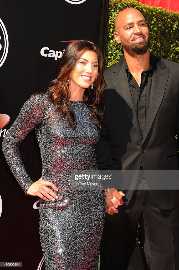 USA women's soccer player Hope Solo (L) and former NFL player Jerramy Stevens arrive at the The 2015 ESPYS at Microsoft Theater on July 15, 2015 in Los Angeles, California.