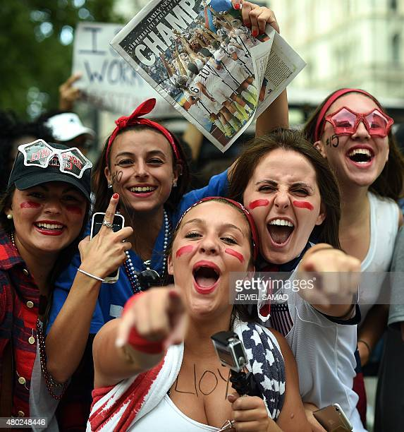 USA women's soccer team fans cheer before the ticker tape parade in New York on July 10 to celebrate the team World Cup victory AFP PHOTO/JEWEL SAMAD