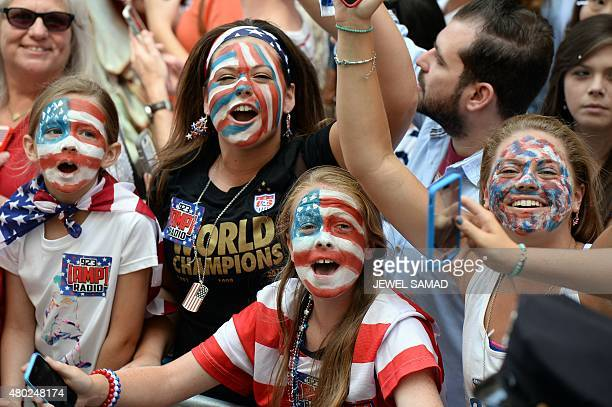 USA women's soccer team fans cheer during the ticker tape parade in New York on July 10 2015 celebrating the team World Cup victory AFP PHOTO/JEWEL...