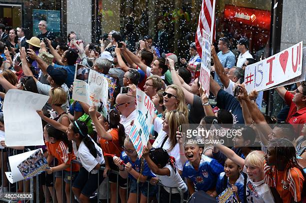 USA women's soccer team fans cheer during the ticker tape parade in New York on July 10 to celebrate the team World Cup victory AFP PHOTO/JEWEL SAMAD