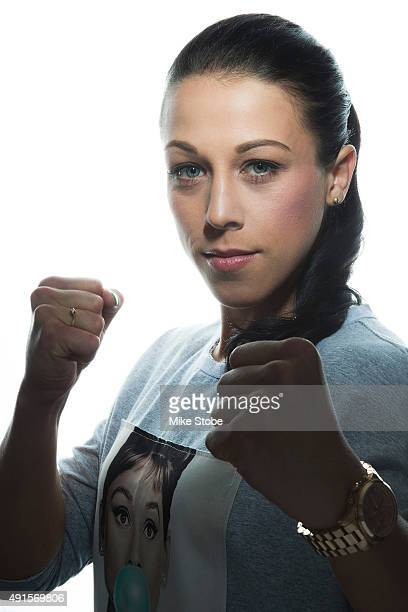 UFC women's strawweight champion Joanna Jedrzejczyk poses for a photo at the London NYC hotel ahead of UFC 193 on October 6 2015 in New York City