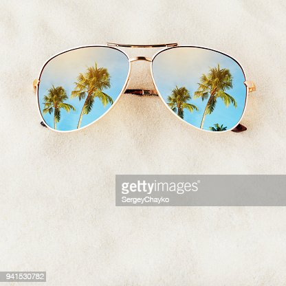 Women's Sunglasses no title on the sand with space for text, top view. Journey to the sea : Stock Photo