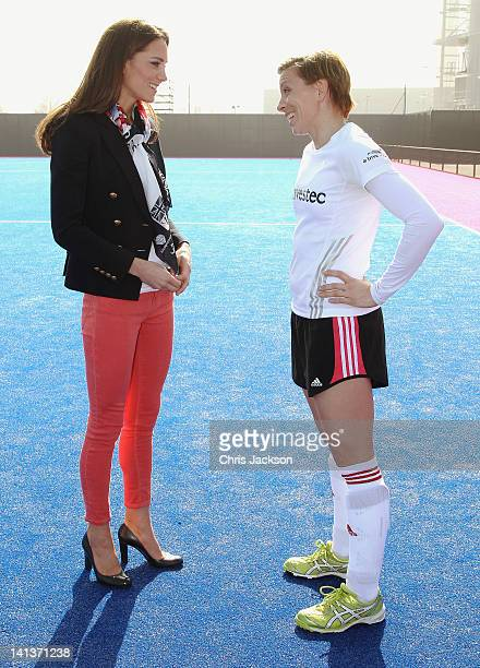 Women's Team GB hockey captain Kate Walsh watches Catherine Duchess of Cambridge play hockey with the GB hockey teams at the Riverside Arena in the...