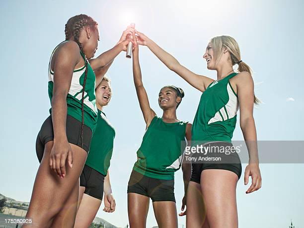 Women's track relay team celebrating