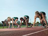 Women's track team at starting blocks