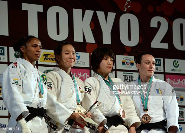 Women's under 52kg class winner Yuki Hashimoto of Japan poses with silver medalist Erika Miranda of Brazil and bronze medalists Ai ShiShie of Japan...