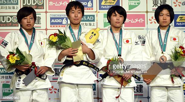 Women's under 52kg winner Yuki Hashimoto of Japan poses with silver medalist Yuka Nishida of Japan and bronze medalists Ai Shishime of Japan and...