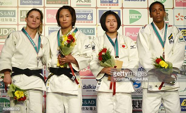 Women's under 57kg winner Kaori Matsumoto of Japan poses with silver medalist Telma Monteiro of Portugal and bronze medalists Tsukasa Yoshida of...