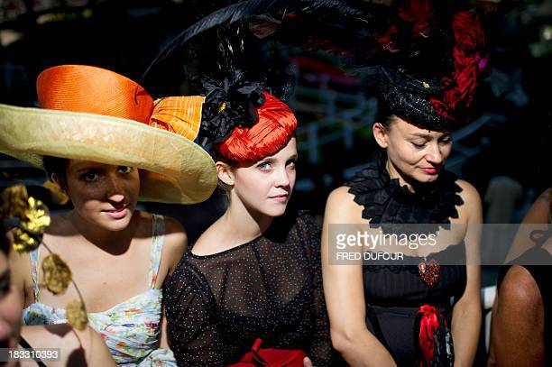 Womens wearing fashionable hats attend the 90th edition of the Qatar Prix de l'Arc de Triomphe at the Longchamp racecourse outside Paris on October 2...