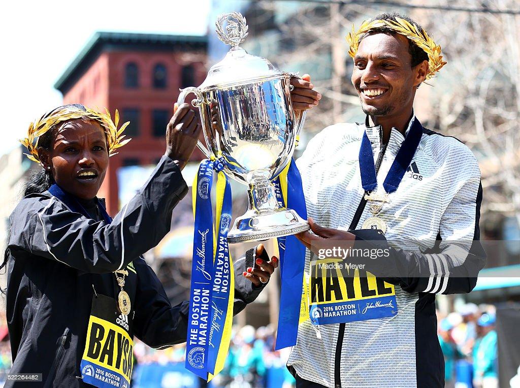 Women's winner Atsede Baysa of Ethiopa and men's winner Lemi Berhanu Hayle of Ethiopia pose at the finish line after winning the 120th Boston Marathon on April 18, 2016 in Boston, Massachusetts.